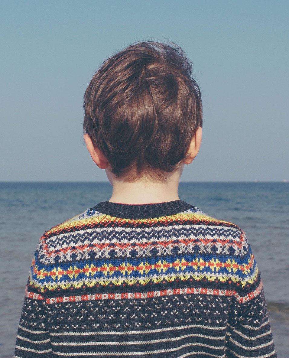 Child Looking at the Ocean